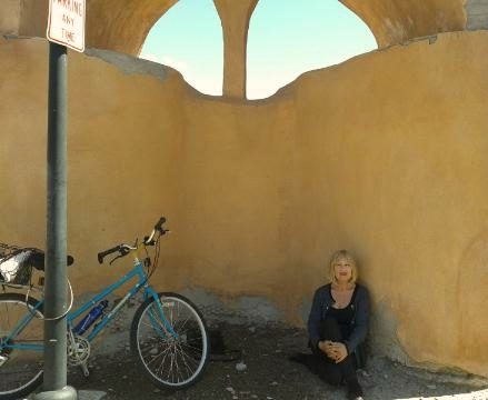 The author in Old Town, Albuquerque with her bicycle.  Photo credit:  ka